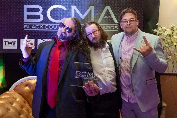 Stourbridge News: WEAK13 frontman Nick J Townsend, with bass player Wesley Smith and drummer Justin James, who appeared in the video, at the awards ceremony