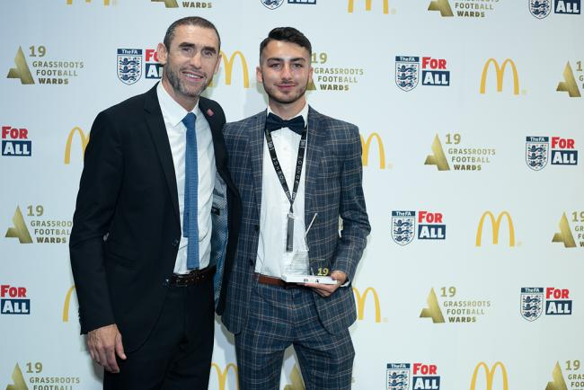 Martin Keown presents the Grassroots Match Official of the Year award to Chad Roberts