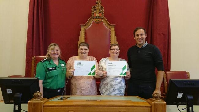 Carol Littler, St John Ambulance, Susan Baker, Diane Baker and Councillor Keiran Casey in the Dudley Council House Chamber