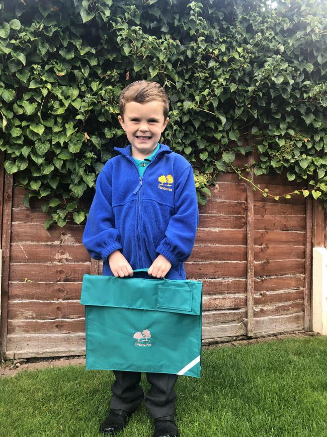 Edward Nash aged 4 off for his first day at Ten Acres School. He was very excited for his first day in Miss Austin's class.