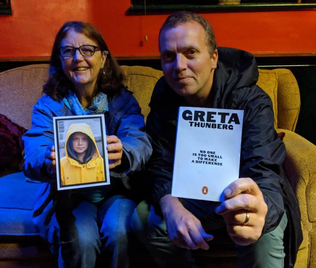 Campaigners Catherine Maguire and Mark Binnersley with Greta Thunberg's book