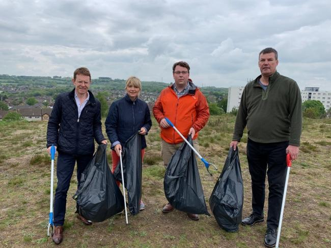 Andy Street, Mayor of the West Midlands, cleaning up with councillors Debbie Clancy, Gary Sambrook and Adrian Delaney.