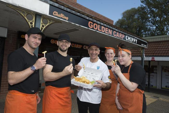 Theo Ellina (centre) and his team from the Golden Carp