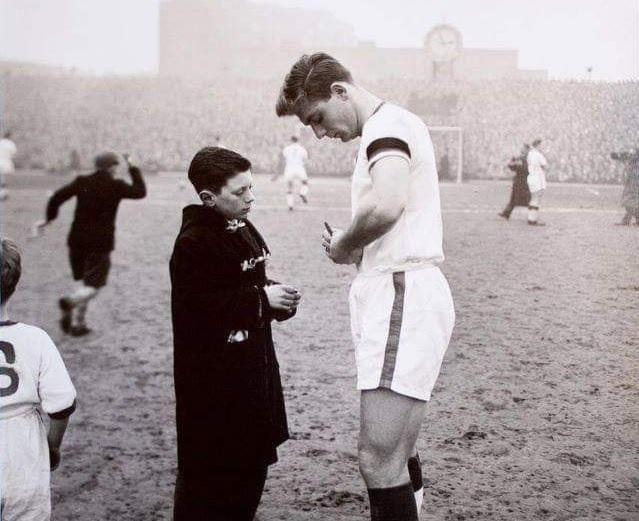 Duncan Edwards with a young fan, just weeks before the Munich air crash tragedy.