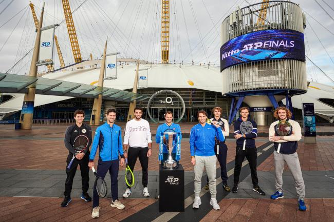 The eight singles players pose in front of the O2 Arena