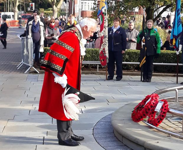Stourbridge News: Mayor of Dudley Cllr David Stanley lays a wreath at Remembrance Day parade. Pic - Dudley Council
