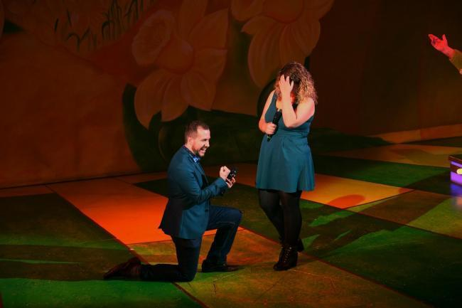 Tom Jeavons took his bride-to-be Zoë Mitchell by surprise and proposed on stage at Theatr Clwyd in Mold [Image by Theatr Clwyd/@ClwydTweets]