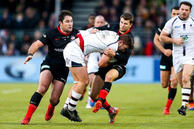 CRUNCH TIME: Sam Lewis being tackled by Richard Wigglesworth and Brad Barritt at Saracens. PIC: Rogan/JMP