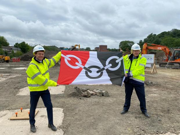 Stourbridge News: Andy Street, Mayor of the West Midlands, and Prime Minister Boris Johnson hold up the Black Country flag