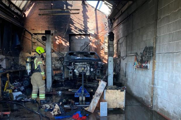 A car and motorbike were destroyed and the roof severely damaged in the fire. Pic courtesy of Lee Baker - West Midlands Fire Service