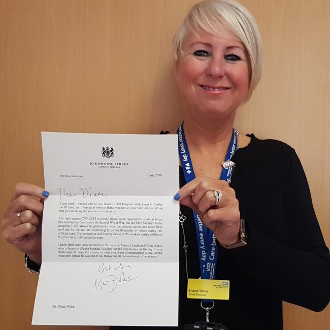 Diane Wake, chief executive oif the Dudley Group NHS Foundation Trust, with the letter from Boris Johnson.