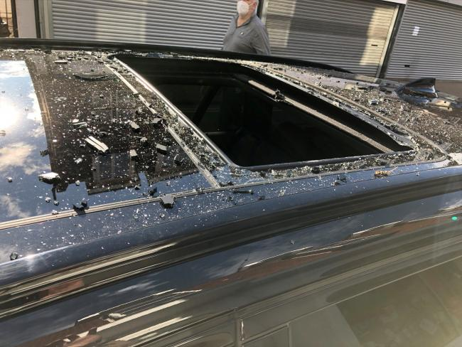 The shattered sunroof of a car parked in Market Street which was attacked by vandals