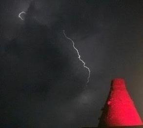Lightning over Wordsley Glass Cone which was lit up to mark  the red alert event to raise awareness of the impact of the Coronavirus lockdown on live music. Picture: Stage Audio Services.