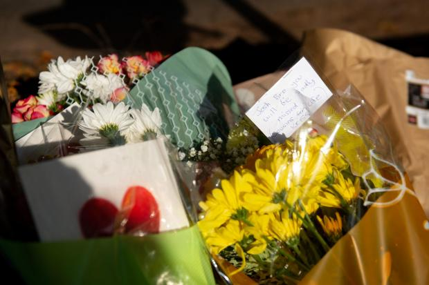 Stourbridge News: Flowers at the scene. Jacob King/PA Wire