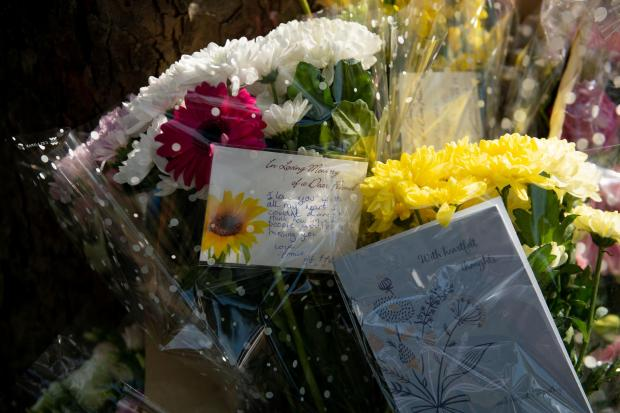 Stourbridge News: Flowers at the scene. Pic: Jacob King/PA Wire