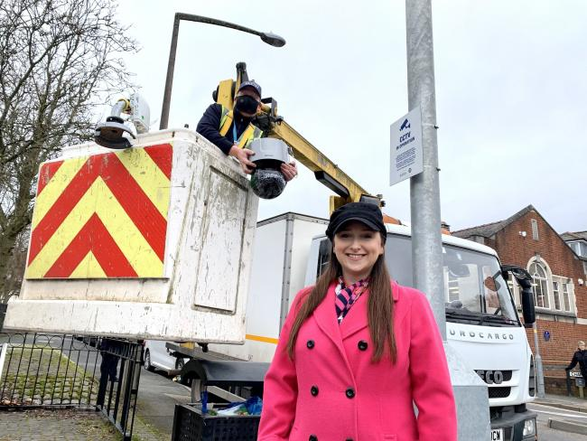 Cllr Laura Taylor checks out work to install the new cameras in Lye