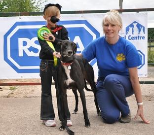 Georgia Hawkins and dog Poppy with judge, Louise Mason from Kidderminster Dog Club.