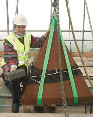 Lady Cobham with the time capsule at the top of The Obelisk before the final piece is lowered into place