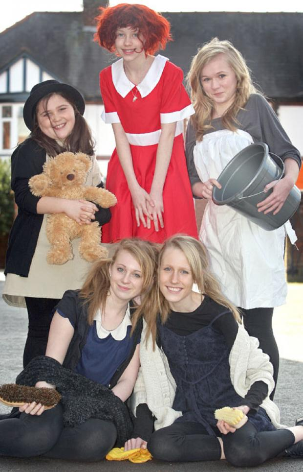 Left to right, back, Amelia Jones, aged ten, Amber Hughes as Annie, aged 12, Beth Henwood, aged 15, front, Holly Watson, aged 14, and Melissa Parsons, aged 13. Buy photo: 111210J