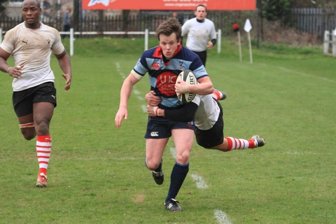 Matt Farrington is tackled against Rugby Lions
