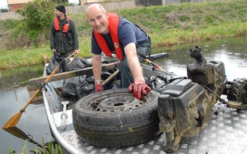 Stephen Beardes and Terry Speake collect rubbish from the canal. Buy photo: 161229M