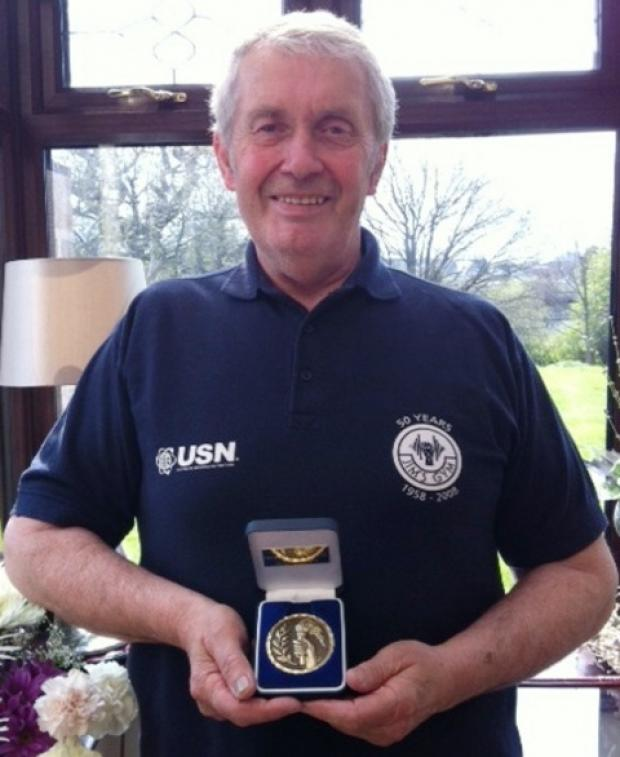 Jim Charles with his latest accolade.
