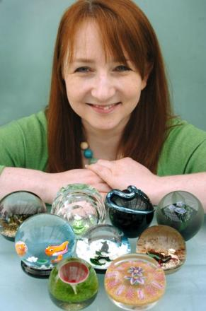 Kari Moodie from Broadfield House Glass Museum with paperweights from their annual show