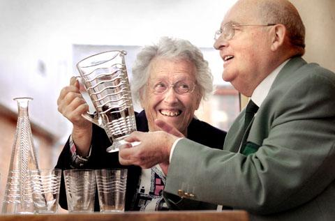 Barbara Webb & Malcolm Andrews with 1930's glass. Buy photo: 251242L
