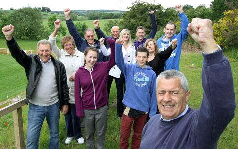 Campaigners led by cllr Dave Tyler (front) celebrate victory at DK Rugby Club, Wall Heath, after a plan for a massive quarry next to the club was thrown out. Buy photo: 251249AM