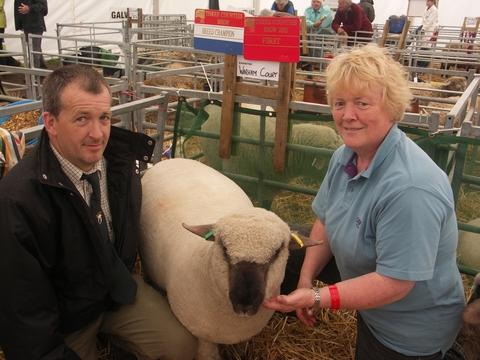 Just champion: Jane McMinn and stockman Peter Coney with the ram lamb that took the breed champion award in the Dorset Down category.