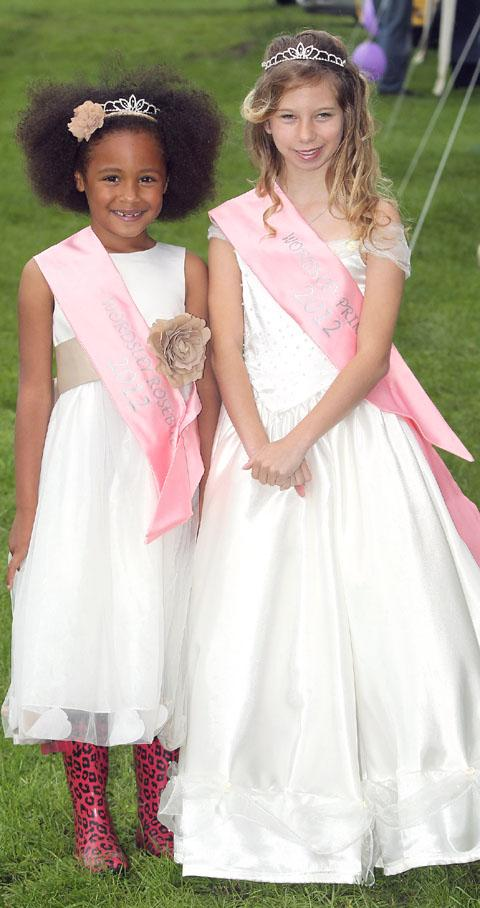 Wordsley Rosebud 2012 Kenzie Del Kiffin, aged six from Brierley Hill, and Wordsley Princess 2012 Charlotte Pickett, aged 11, from Kingswinford. Buy photo: 261214J