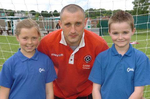 Sheffield United fitness manager David Morrison with pupils Amy Blackadder and Rhys Thomas, both aged 11. Buy photo: 261244K