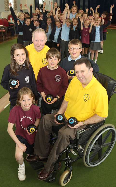 L-r, back, Isobel Coxon (aged ten, St Mary's), Brian Sable (president - Midlands County Bowls Association), Oscar Slim (aged ten, Dawley Brook), William Wood (aged ten, St Mary's)). Front, Leah Felton (ten, Dawley Brook) & David Powell. Buy pic 261205J