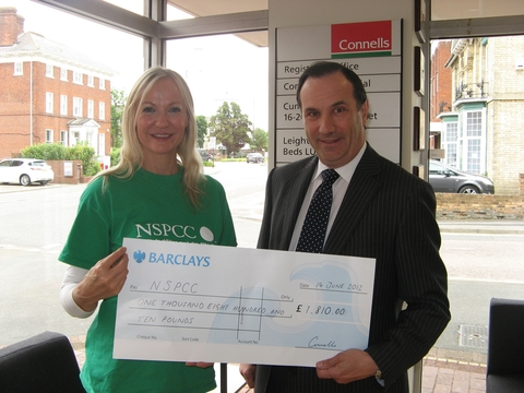 Geraldine Harmon, Corporate Manager at the NSPCC receives the cheque from Connells chief executive Stuart Flavell.