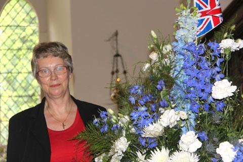Jill Nicholls, lay reader at St Marys Church, with one of the displays at their flower festival