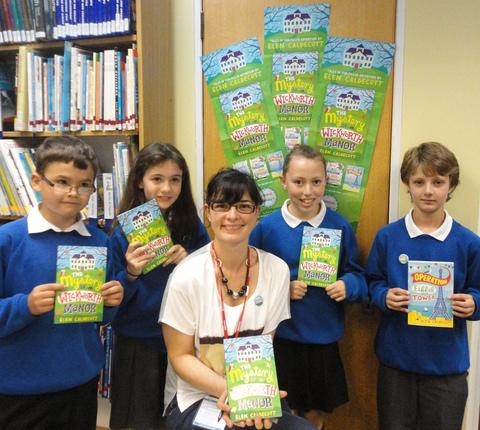Left to right – Year six pupils - Kuearn Reeves-Le-Gallez and Theresa Painter, both aged 11, with author Elen Cauldecott, and year five youngsters - Catrin Wheeler and Aaron Howles, both ten.