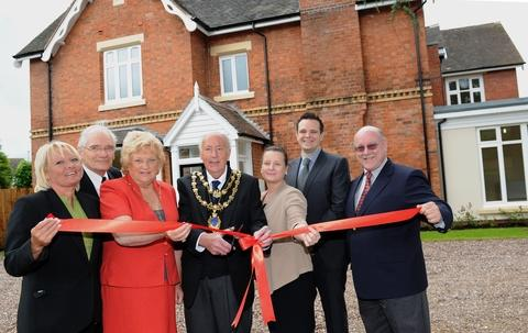 Impressive home: Kidderminster Mayor  John Aston cuts the ribbon to officially open The Briars,