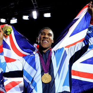 Anthony Joshua celebrates with his gold medal following his super-heavyweight final against Italy's Roberto Cammarelle