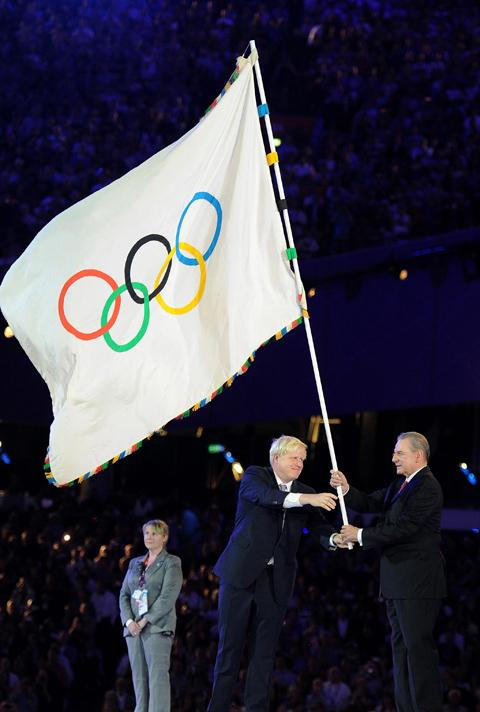 Mayor of London Boris Johnson hands over the Olympic flag