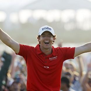 Rory McIlroy of Northern Ireland reacts to his victory after a birdie putt on the 18th green during the final round of the PGA Championship (AP)