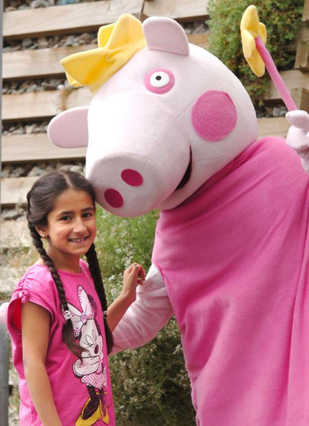 Mimi Willkha (7) meets Peppa Pig. Buy photo: 351206L