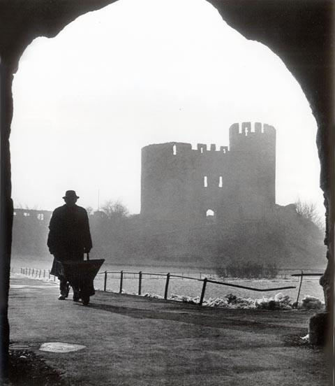 A man and his wheelbarrow in the courtyard at Dudley Castle on a cold winter's day in 1958.