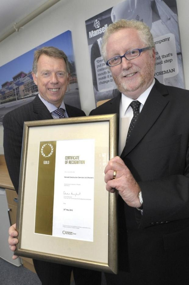 Stourbridge News: Gold standard: Mansell regional managing director Steve Davies, left and training manager Jeremy Lydiatt with the award certificate.