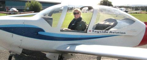 Jemma Newton at the controls of a Grob 115 D Heron aircraft during her training in Dundee for her first solo flight