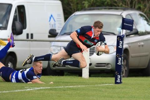 Matt Farrington dives over for a DK try