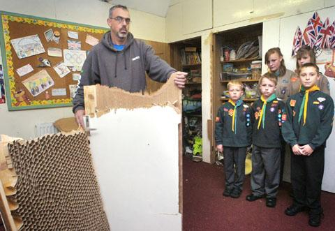Stourbridge News: Scout group leader Andy Garratt with a broken cupboard door and scouts Dylan Passmore, William Passmore, Kyle Skidmore, Skye Timmins and Jodie Hickman. Buy photo: 411207L.