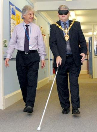 Michael Lomax, rehabilitation worker with Dudley Council's Vision Support Service and Cllr Melvyn Mottram