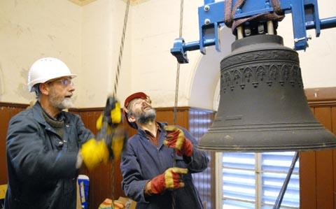 l-r Dave Struckett, Andy Gray hoisting bell up to tower at Christ Church in Lye