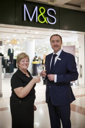 Gwyn Morton and store manager, Mark Brown toast the new-look store