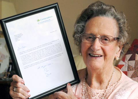 Marian Timmins proudly shows off her letter from Prime Minister David Cameron. Buy photo: 491250M